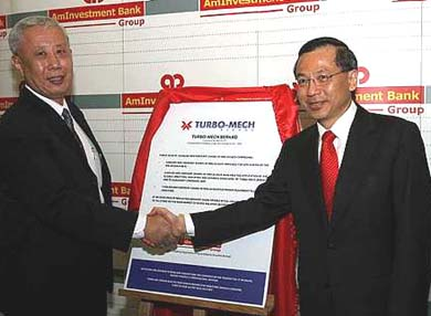 Gan Ching Lai (left) and AmInvestment Bank managing director T.C. Kok at the launch